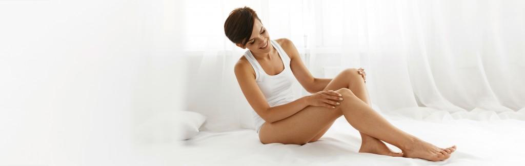 Beauty Body Woman. Beautiful Girl Touching Epilated Long Legs